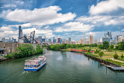 istock The Chicago River and downtwn Chicago skylinechicago, river, lake, michigan, urban, mississippi, great, boat, cruise, travel, business, skyline, people, architecture, tourism, landmark, avenue, building, city, blue, sky, water, bridge, illinois 820299090