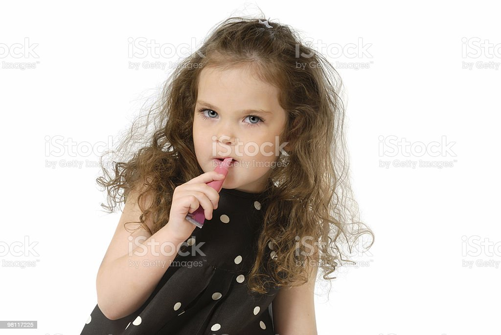 The child and lipstick royalty-free stock photo