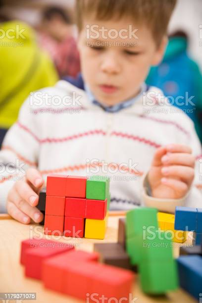 The child collects the puzzle cube multicolored pieces of a wooden picture id1179371075?b=1&k=6&m=1179371075&s=612x612&h=krngj dxwhhheqnr0vz7wf61eulgyytxekjb9lgfdrw=