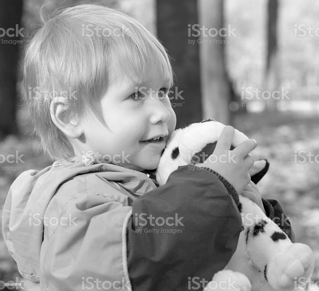 The child embraces a toy stock photo