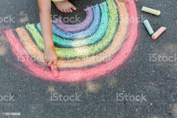 The Child Girl Draws A Rainbow With Colored Chalk On The Asphalt Child Drawings Paintings Concept Education And Arts Be Creative When Back To School Stock Photo - Download Image Now