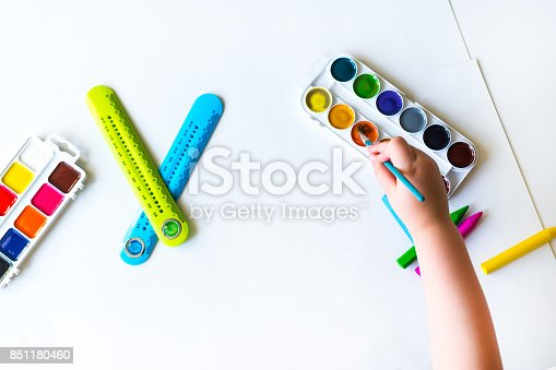 istock The child holds the brush over the palette 851180460