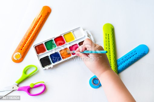 istock The child holds the brush over the palette 851180504