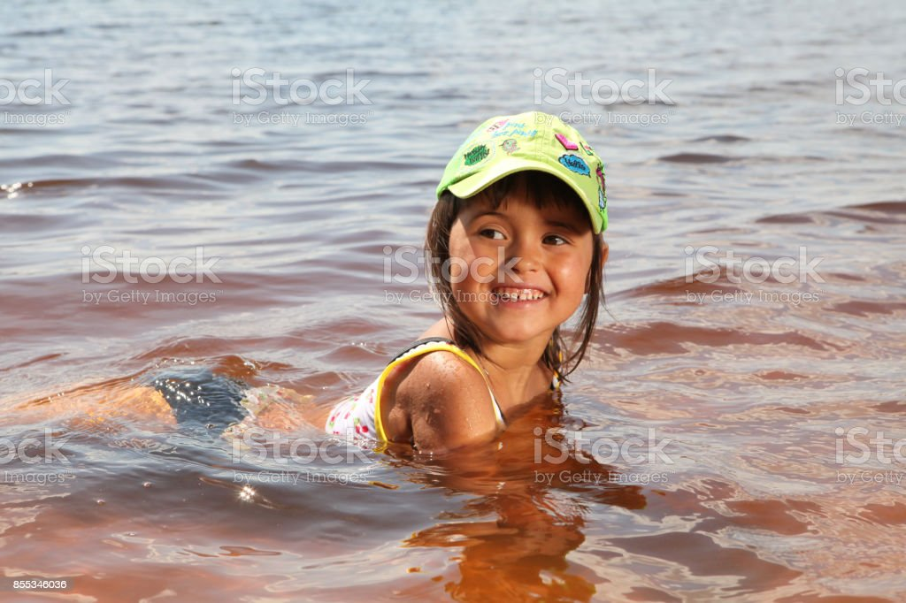 The child is bathing stock photo