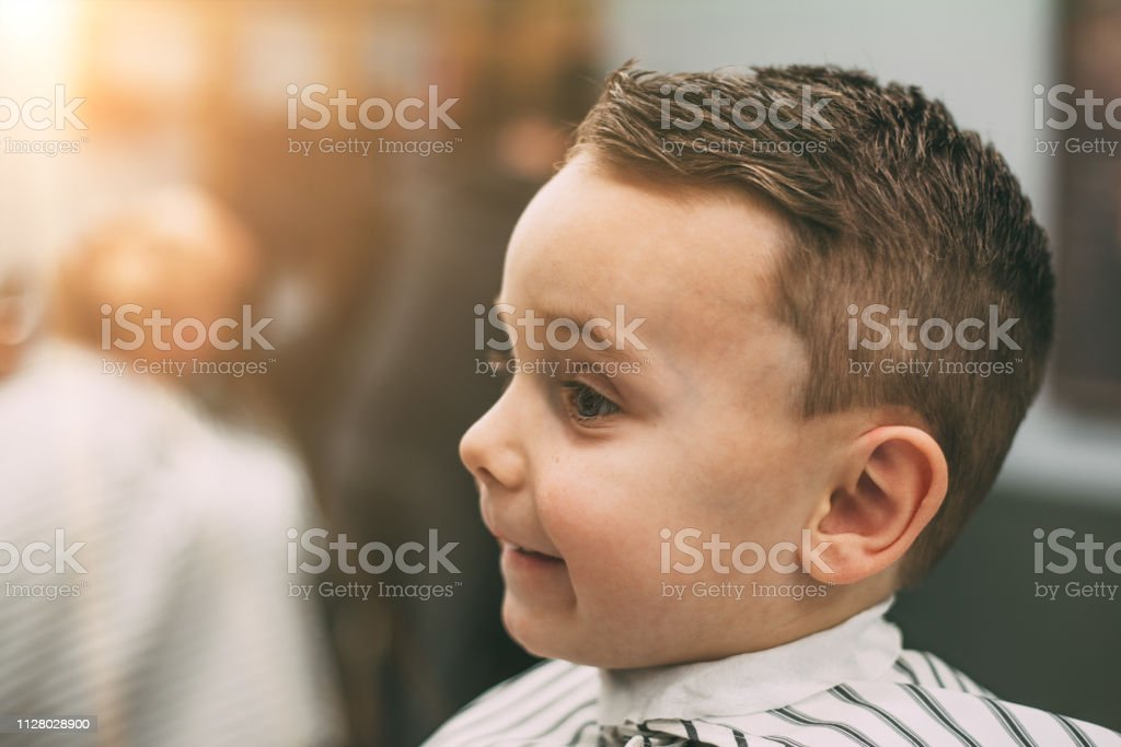 The Child Is Being Cut Hairstyles Stock Photo - Download Image Now