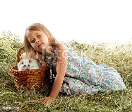 istock The child plays with the rabbit 508942770