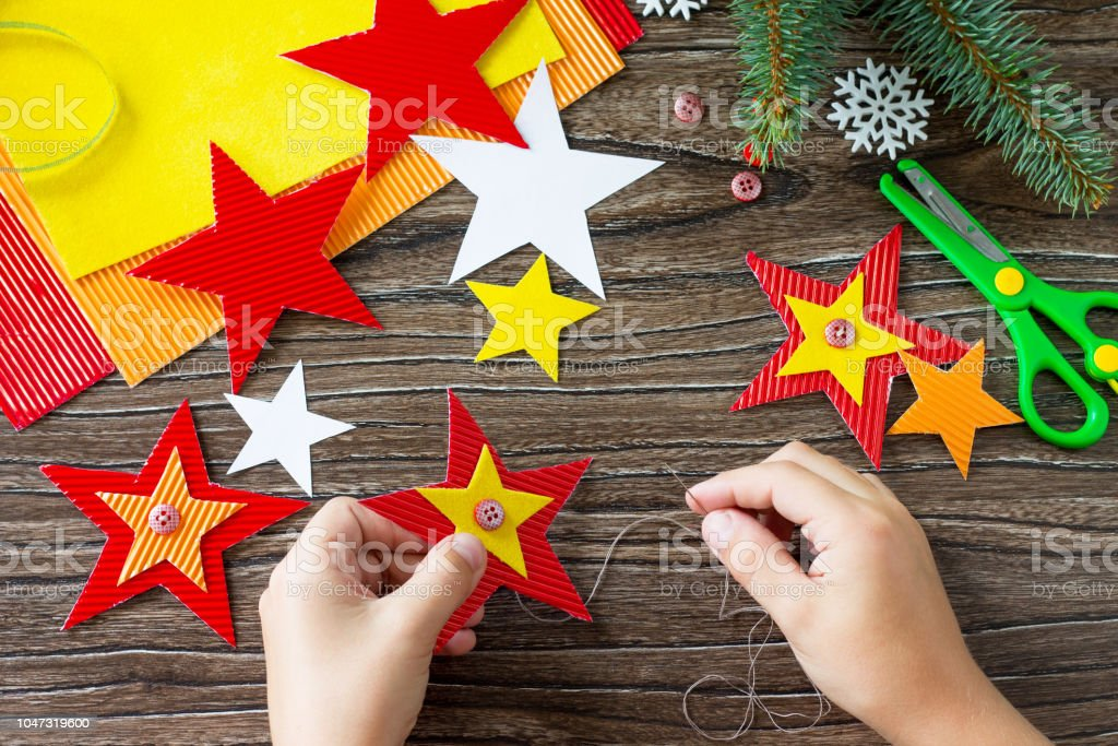 Christmas Tree Toys Handmade.The Child Sews The Parts Christmas Tree Toys Star Gift Handmade Project Of Childrens Creativity Handicrafts Crafts For Kids Stock Photo Download