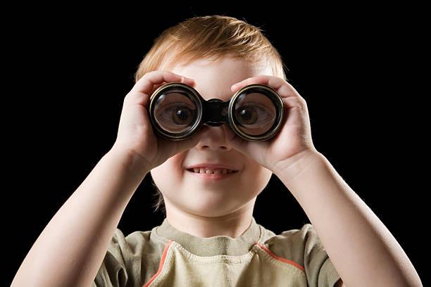 The child watching with binoculars. stock photo