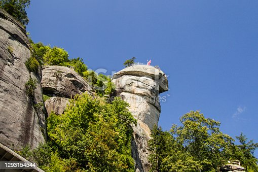Large rock formation is the namesake of Chimney Rock State Park in Lake Lure, North Carolina, USA.