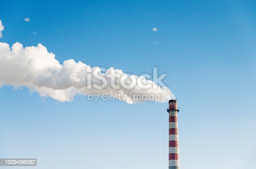 The chimney with smoke into the sky.