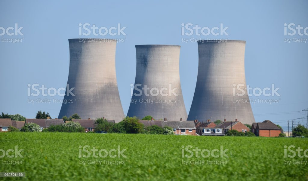 The Chimneys of Didcot power station loom over a village stock photo