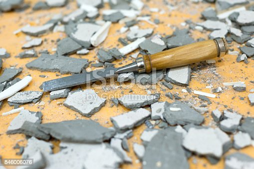 istock The chisel lies in the middle of pieces of cement and plaster 846006076
