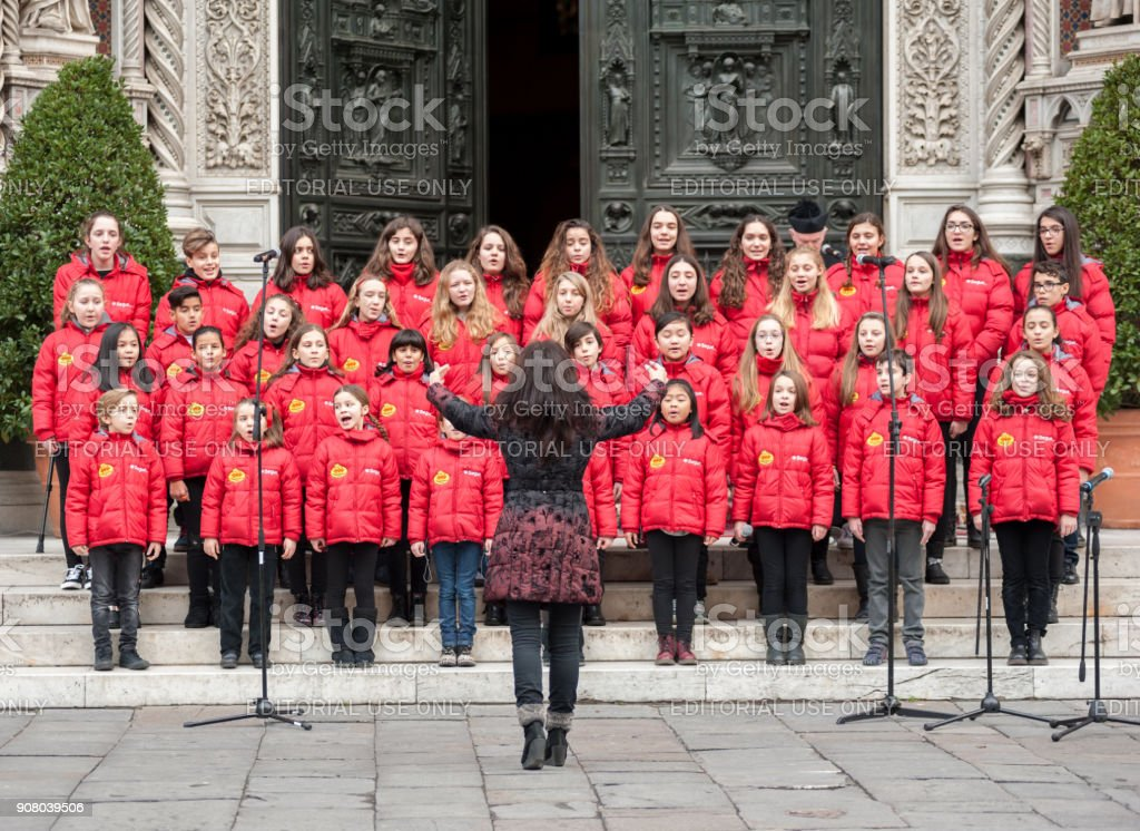 The chorus performs on the Cathedral square of Florence stock photo