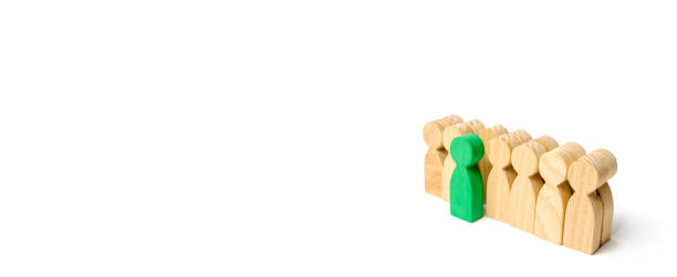the chosen person among others. a human figure of green color stands out from the crowd. wooden figures of people. a talented worker, a successful choice. promotion. concept of search for worker. - advertising isometric stock photos and pictures