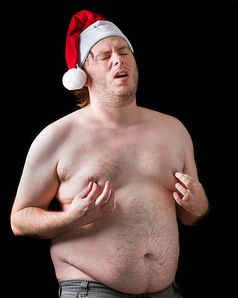 the christmas gift - naked santa claus stock pictures, royalty-free photos & images