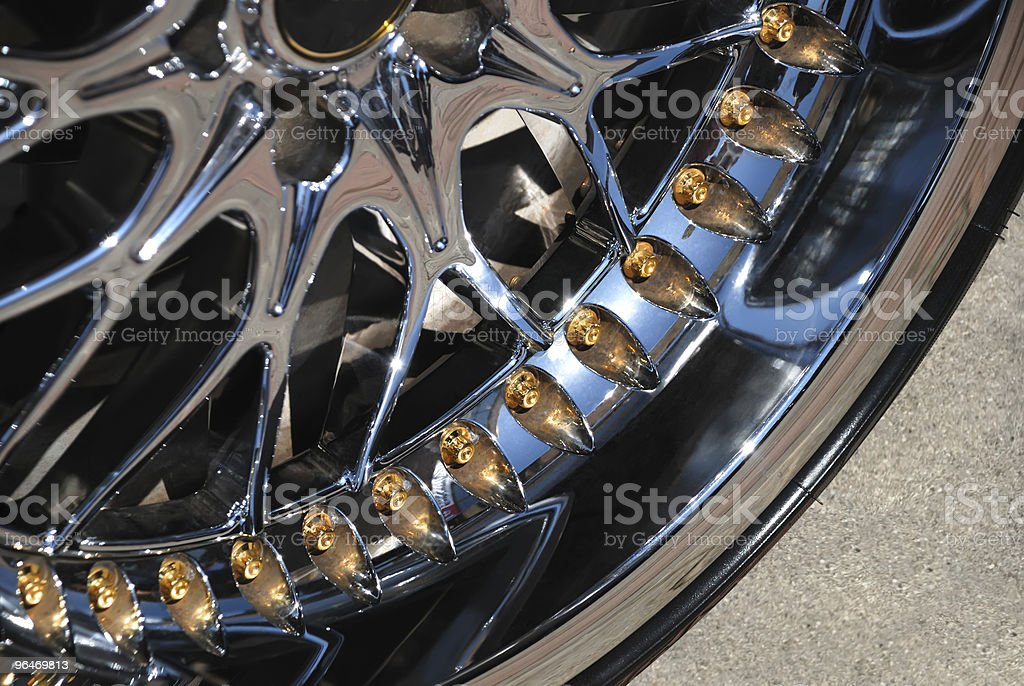 The chromeplated rim of a wheel royalty-free stock photo