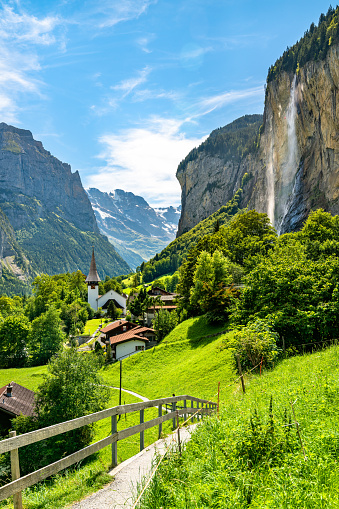 The village church and the Staubbach Falls in Lauterbrunnen - the canton of Bern, Switzerland