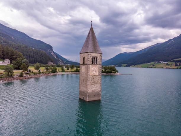 The church bell tower in the Lake Resia in Italy – zdjęcie