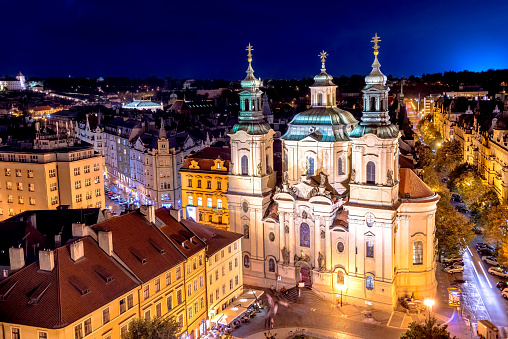 The Church of Saint Nicholas in the Old Town of Prague. View from Old Town Hall at night. Czech Republic