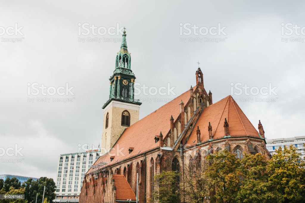 The Church of St. Mary in Berlin in Germany on the Alexanderplatz square. stock photo