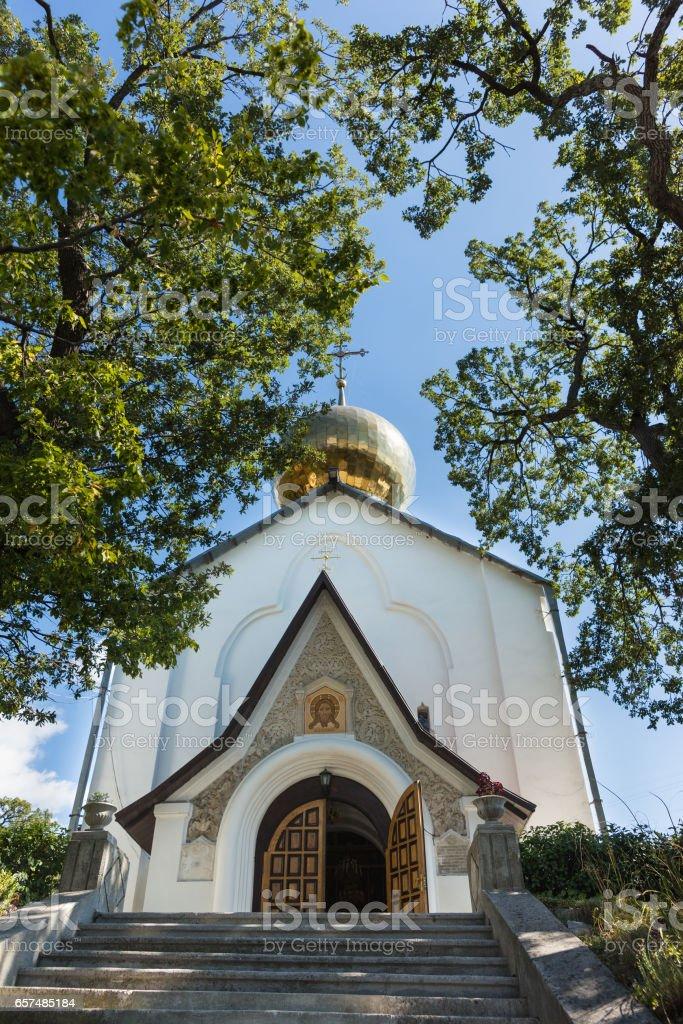 The Church of St. Nicholas the Wonderworker and Martyr tsarina Alexandra is the patron Saint of the Royal family. Yalta, Crimea, Russia stock photo