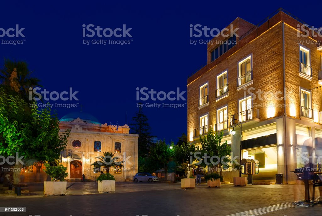 The Church of St Titus, or Agios Titos, in centre of Heraklion, Crete, at night with an almost full moon above it. stock photo