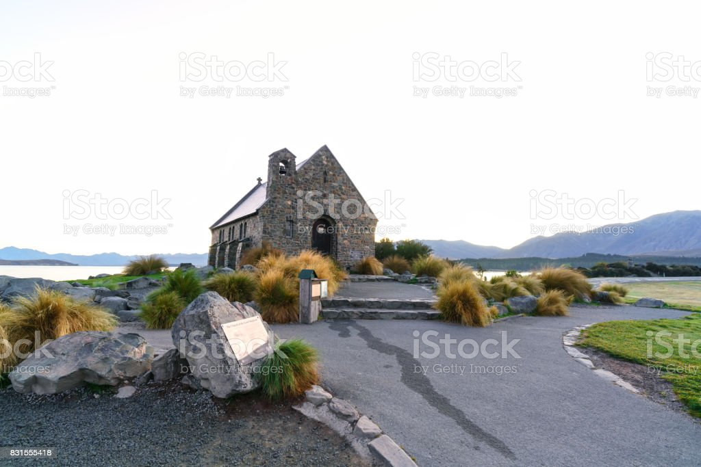 The Church of the Good Shepherd is situated on the shores of Lake Tekapo on white background , Mackenzie District, Canterbury Region, South Island of New Zealand stock photo