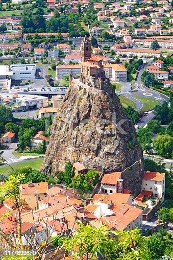 istock The church Saint-Michel is a romanesque church built on a volcanic peak, the rock of Aiguilhe, 82 meters high located near Puy-en-Velay, in the French department of Haute-Loire and the Auvergne region 1177699870