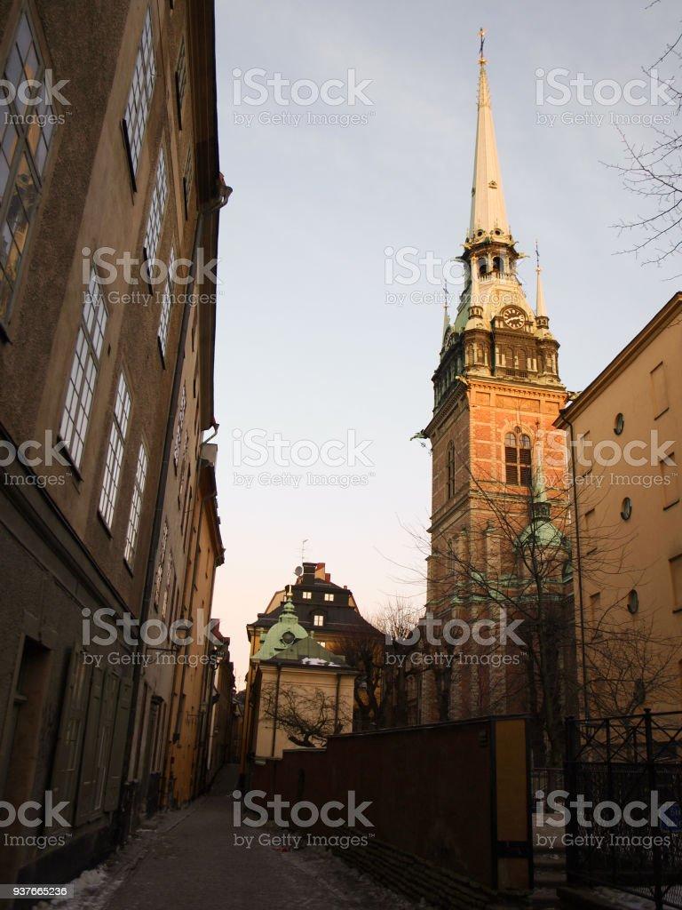 The church Tyska kyrkan with street in Stockholm, Sweden stock photo
