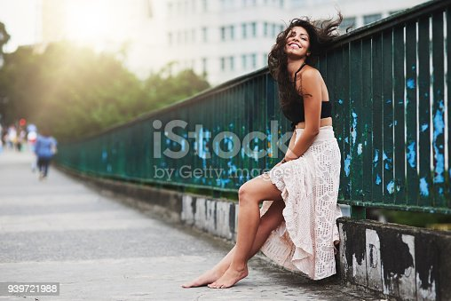 Portrait of an attractive young woman out in the city
