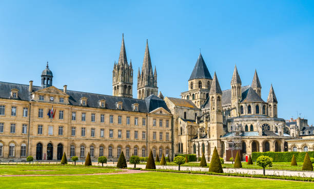 The city hall and the Abbey of Saint-Etienne in Caen, France The city hall and the Abbey of Saint-Etienne in Caen - Normandy, France abbey monastery stock pictures, royalty-free photos & images