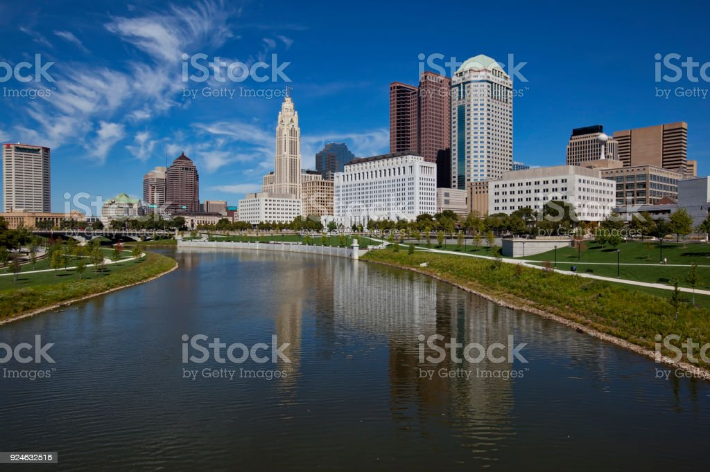 The city of Columbus, Ohio is reflected in the Scioto River. stock photo