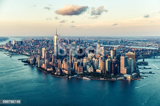 Image of the Manhattan skyline at sunset from an elevated angle.