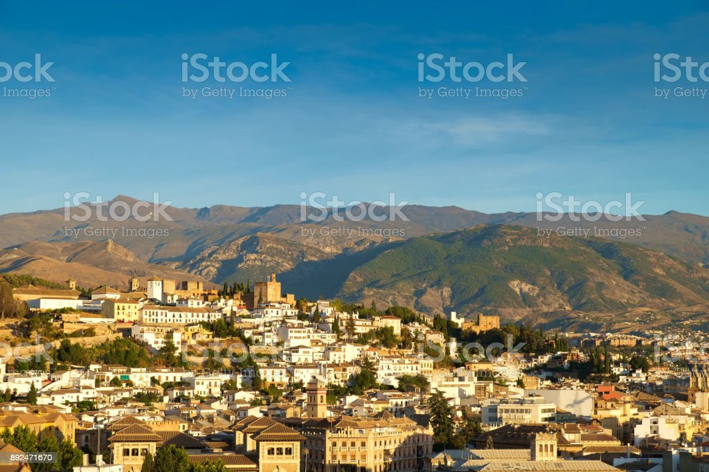 The city of Granada, Adalucia, Spain with the Sierra Nevada in the background. stock photo