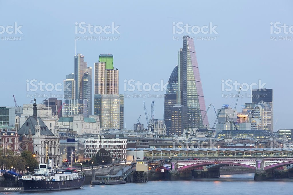 The City Of London in a moonlight at dusk stock photo