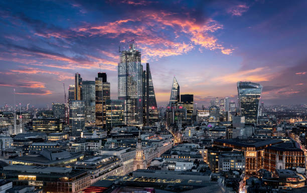 The City of London just after sunset, United Kingdom The City of London, financial district of the Metropole, just after sunset with illuminated buildings and cloudy sky, United Kingdom london england stock pictures, royalty-free photos & images