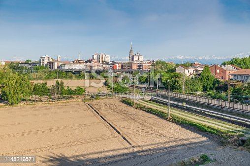 City seen from the surrounding countryside. The bell tower of the Cathedral of Novara and the dome of the Basilica of San Gaudenzio are visible. Novara is an important city in northern Italy, it is the second most populous city in Piedmont after Turin