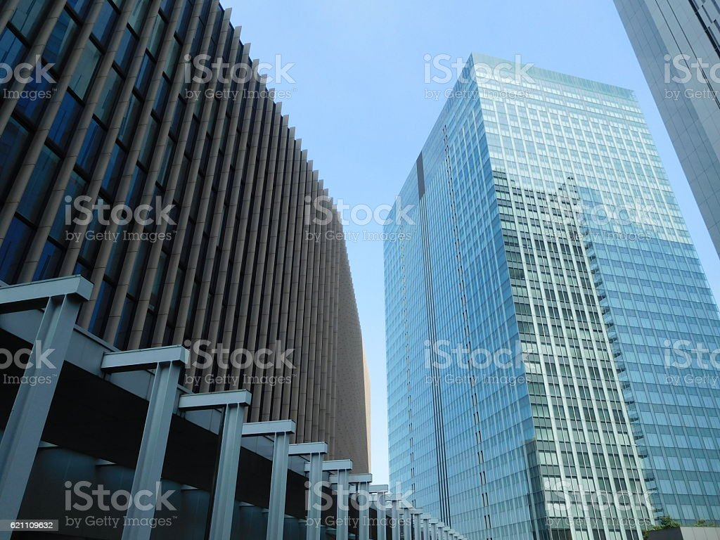 The cityscape among skyscrapers under the blue sky stock photo