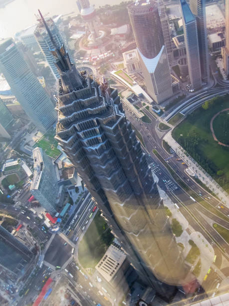 The cityscape of Shanghai with the Jin Mao Tower in the foreground. Lujiazui, Pudong, Shanghai, China The cityscape of Shanghai with the Jin Mao Tower in the foreground. Lujiazui, Pudong, Shanghai, China jin mao tower stock pictures, royalty-free photos & images