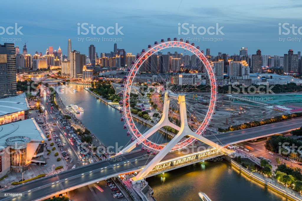 The Cityscape of Tianjin Eye and Tianjin Urban Skyline at Dusk stock photo