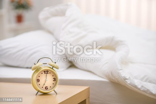 istock The classic clock on the background of the bed 1144411114