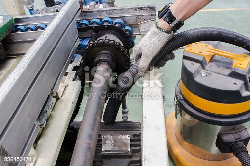 istock The Cleaning and maintenance motor  Conveyor chain drive 836450474