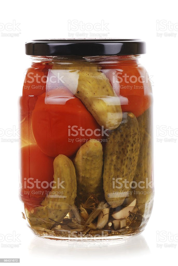 The clear glass jar of colorful pickled vegetables royalty-free stock photo