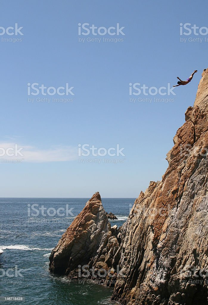 La Quebrada Cliff diver stock photo