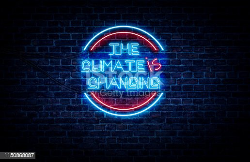 A global warming awareness material; A blue and red neon sign that reads: The Climate IS changing