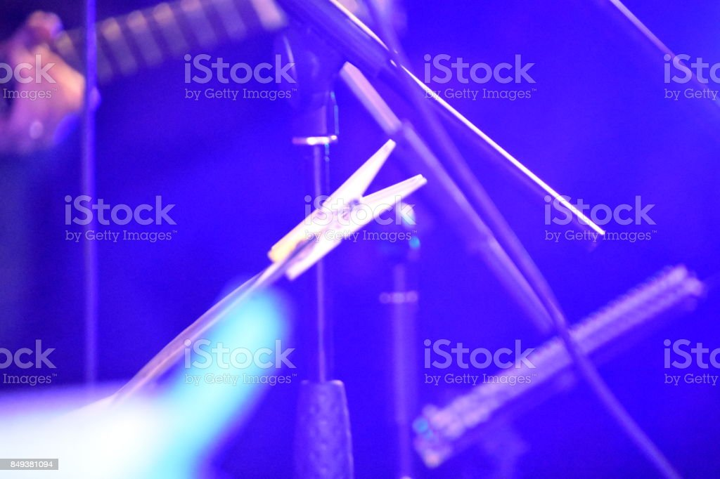 The clip holds musical notes stock photo