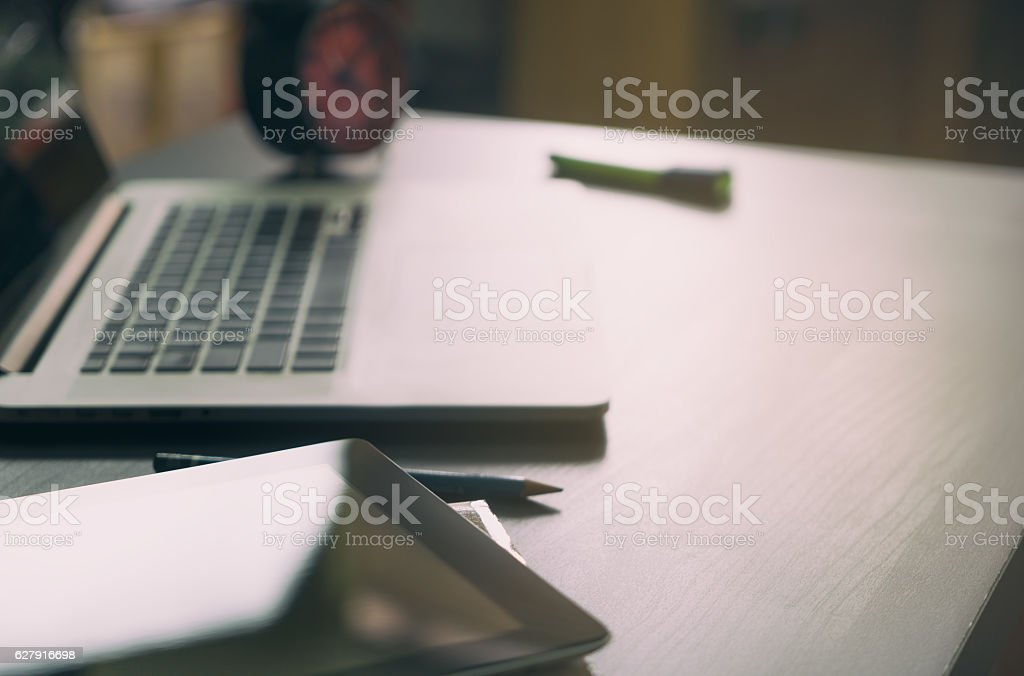 The clock on empty office table after work gone home. stock photo