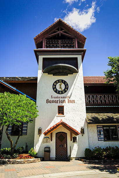 the clock tower of the bavarian inn in frankenmuth mi stock photo