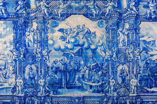 Porto, Portugal - November 17, 2017: The cloister walls of Porto's Cathedral are decorated with the traditional Portugese blue and white painted tin-glazed ceramic tiles called Azulejos.
