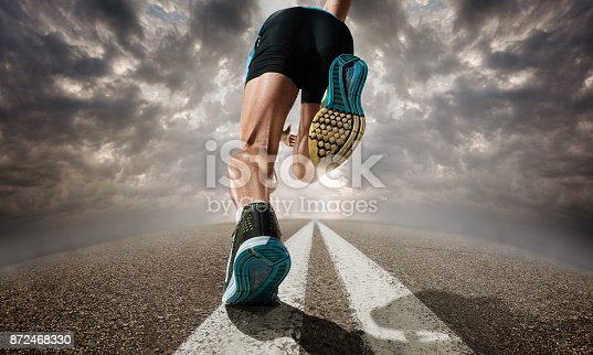 istock The close up feet of man running and training on running track 872468330